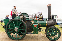&copy; Licensed to London News Pictures. 29/05/17  ALTRINCHAM ,GREATER MANCHESTER,UK.  <br /> <br /> Ashley Hall Traction Engine Rally today (Monday 29th May 2017). The rally , hosted at Ashley Hall for the third year running , took place over the bank holiday weekend from Saturday 27th May until Sunday 29th May. Pippa Humphreys , five ,  with her dad Lee Humphries and Jeremy Sheldrake riding an engine restored by Fred Dibnah.<br />   <br /> Photo credit: CHRIS BULL/LNP