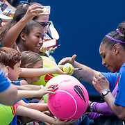 2019 US Open Tennis Tournament- Day Five.  Serena Williams of the United States signs autographs after her win against Carolina Muchova of the Czech Republic in the Women's Singles Round Three match on Arthur Ashe Stadium at the 2019 US Open Tennis Tournament at the USTA Billie Jean King National Tennis Center on August 30th, 2019 in Flushing, Queens, New York City.  (Photo by Tim Clayton/Corbis via Getty Images)