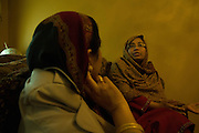 8 Nov 2013. Anjum Ara, a Pakistani matchmaker speaks with a client. Photo by Sehar Mughal/NYCity Photo Wire