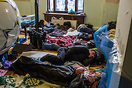 KIEV, UKRAINE - DECEMBER 4: Anti-government protesters sleep on the floor in the occupied City Hall building on December 4, 2013 in Kiev, Ukraine. Thousands of people have been protesting against the government since a decision by Ukrainian president Viktor Yanukovych to suspend a trade and partnership agreement with the European Union in favor of incentives from Russia. (Photo by Brendan Hoffman/Getty Images) *** Local Caption ***