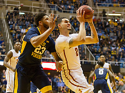 Feb 22, 2016; Morgantown, WV, USA; Iowa State Cyclones forward Abdel Nader (2) drives past West Virginia Mountaineers forward Esa Ahmad (23) during the first half at the WVU Coliseum. Mandatory Credit: Ben Queen-USA TODAY Sports