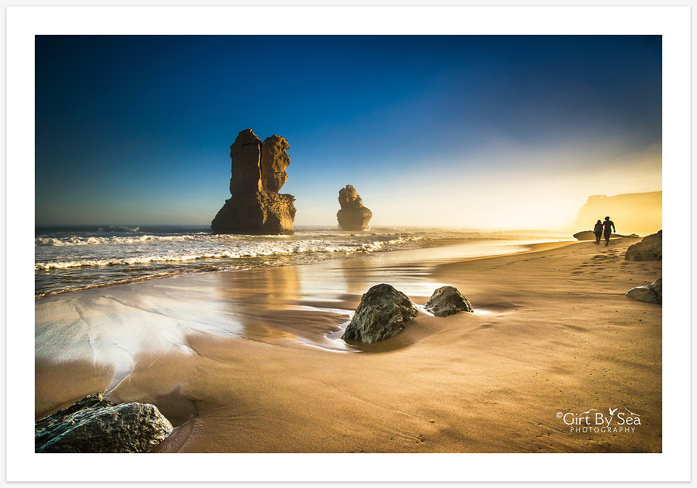 A leisurely afternoon stroll on the beach below Gibson Steps [Great Ocean Road, Victoria, Australia]<br /> <br /> Image ID: 205335. Order by email to orders@girtbyseaphotography.com quoting the image ID, preferred print size &amp; media. Current standard size prices are published on the Pricing page. Custom sizes also available.