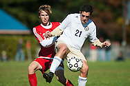 CVU's Joe Parento (12) and Essex's Noah Ferris (21) battle for the ball during the boys soccer game between the Champlain Valley Union Redhawks and the Essex Hornets at Essex High School on Saturday mooring October 10, 2015 in Essex. (BRIAN JENKINS/For the FREE PRESS)