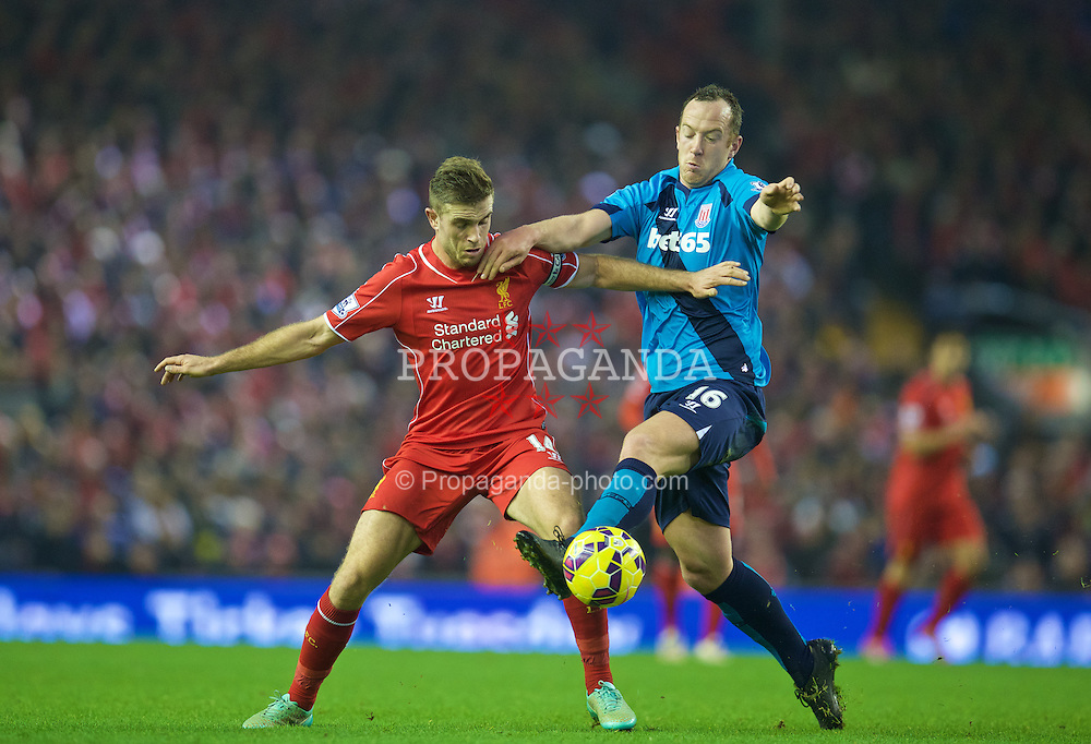 LIVERPOOL, ENGLAND - Saturday, November 29, 2014: Liverpool's Jordan Henderson in action against Stoke City's Charlie Adam during the Premier League match at Anfield. (Pic by David Rawcliffe/Propaganda)