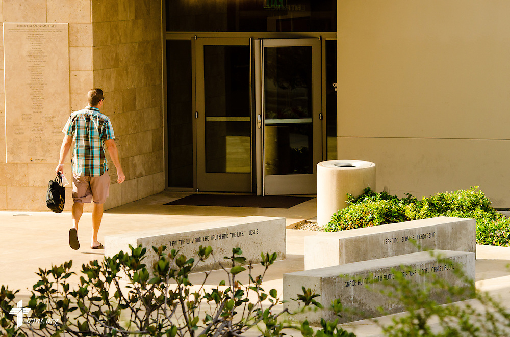 A man walks past the entryway to Robert Alan Grimm Hall at Concordia University Irvine on Wednesday, July 9, 2014, in Irvine, Calif. LCMS Communications/Erik M. Lunsford