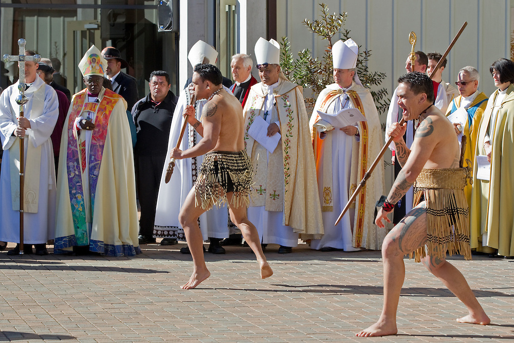 Two Maori warriors challenge the arrival of the hearse watched by clergy including the Archbishop of York, John Sentamu (2nd left) at the state funeral of former Governer General Sir Paul Reeves at the Anglican Cathedral of the Holy Trinity, Auckland, New Zealand, Thursday, August 18, 2011.   Credit:SNPA / David Rowland