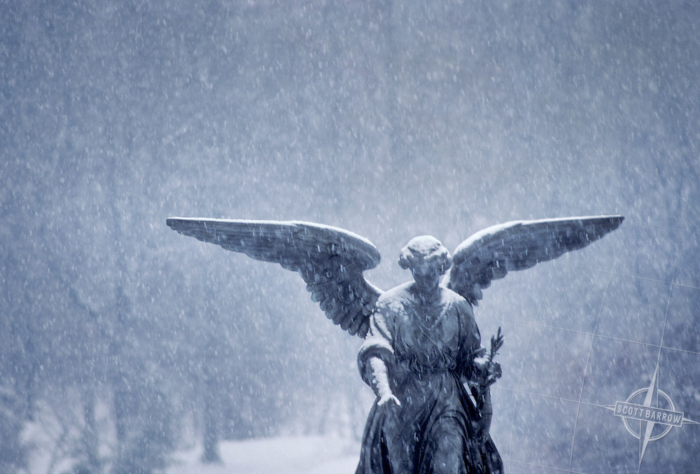 Angel of the Waters at the Bethesda Fountain with a gentle snow falling. Central Park, New York City.