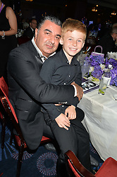 KAM BABAEE and JACOBI CAUDWELL at The Butterfly Ball in aid of Caudwell Children held at the Grosvenor House, Park Lane, London on 25th June 2015