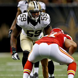 Aug 9, 2013; New Orleans, LA, USA; New Orleans Saints linebacker Rufus Johnson (59) against the Kansas City Chiefs during a preseason game at the Mercedes-Benz Superdome. The Saints defeated the Chiefs 17-13. Mandatory Credit: Derick E. Hingle-USA TODAY Sports