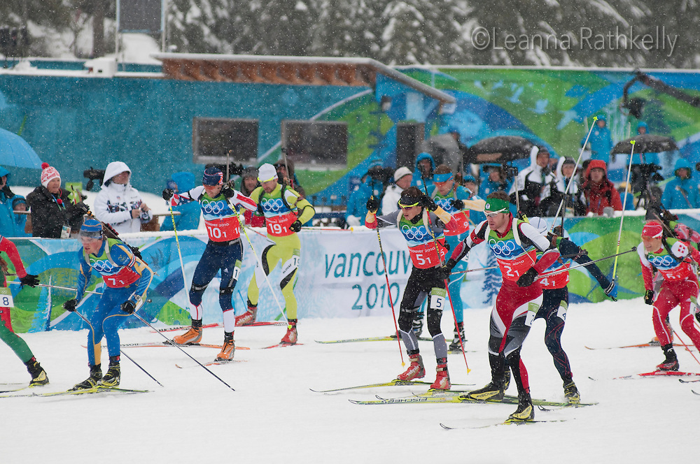 Biathletes compete on a snowy day during the 2010 Olympic Winter Games in Whistler, BC Canada