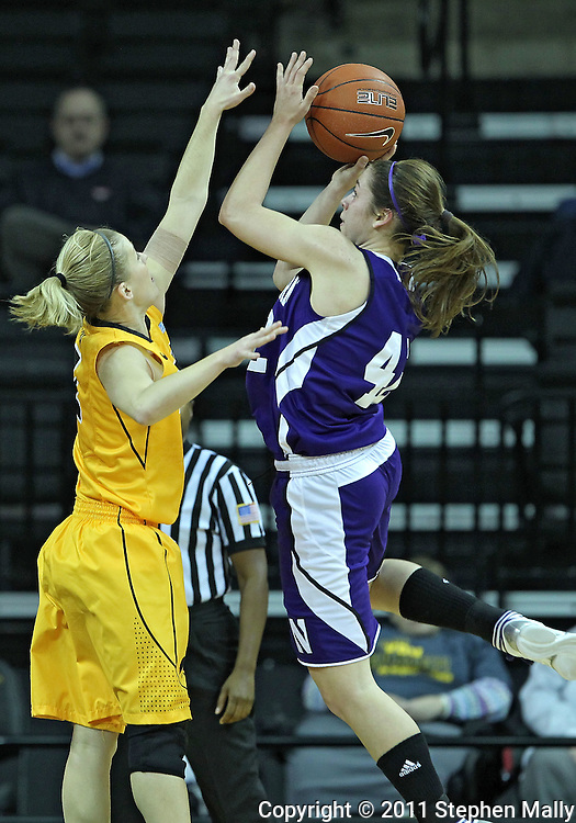 December 30, 2011: Northwestern Wildcats guard Karly Roser (42) puts up a shot as Iowa Hawkeyes guard Kamille Wahlin (2) defends during the NCAA women's basketball game between the Northwestern Wildcats and the Iowa Hawkeyes at Carver-Hawkeye Arena in Iowa City, Iowa on Wednesday, December 30, 2011.