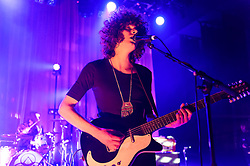 © Licensed to London News Pictures. 08/03/2014. London, UK.   Temples performing live at Shepherds Bush Empire. In this picture - Sam Toms (left), James Edward Bagshaw (right).  Temples are an English psychedelic rock band consisting of members James Edward Bagshaw (singer/guitarist), bassist Thomas Edison Warmsley (bass), Sam Toms (drums) and Adam Smith (keyboards/guitar/vocals).   Photo credit : Richard Isaac/LNP