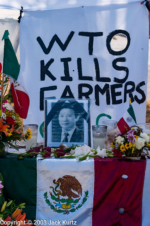 14 SEPTEMBER 2003 - CANCUN, QUINTANA ROO, MEXICO:  An altar with a picture of Lee Kyung-hae during a memorial service for Lee Kyung-hae, a South Korean farmer who committed suicided during a protest against liberalized agricultural trade at the WTO ministerial in Cancun. Tens of thousands of protesters, mostly farmers, came to Cancun for the fifth ministerial of the World Trade Organization (WTO). They were protesting against developed nations pushing to get access to agricultural markets in developing nations. The talks ultimately collapsed after no progress with no agreements reached between the participants.          PHOTO BY JACK KURTZ