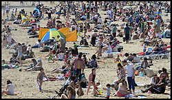 People enjoy the Bank Holiday Sunshine on the Beach in Bournemouth, Monday May 6, 2013. Photo by: Andrew Parsons / i-Images