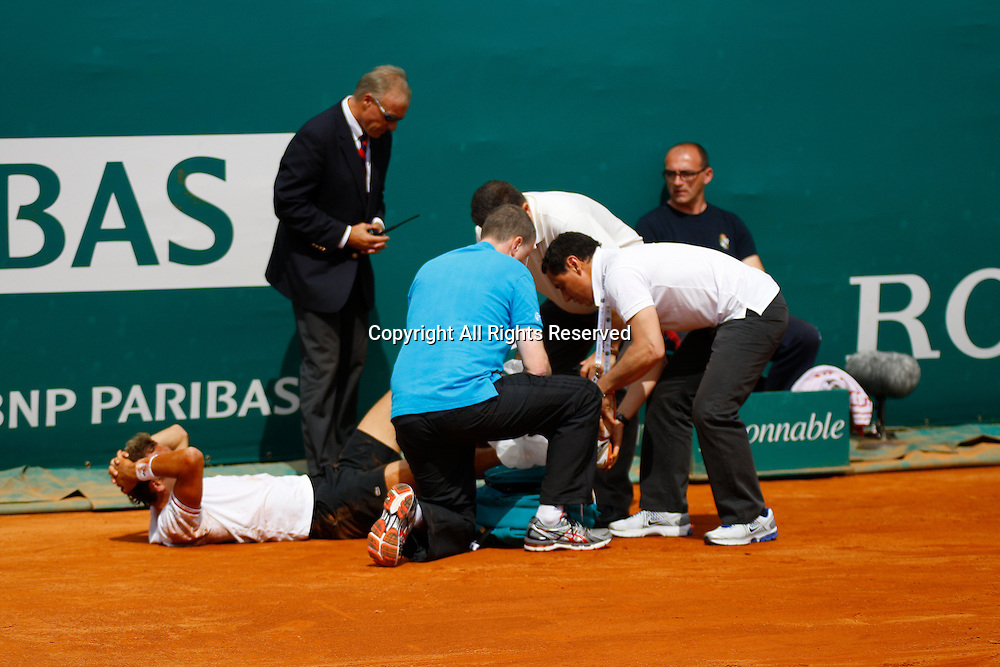 19.04.2012 Monte Carlo, Monaco. Julien Benneteau retired hurt at 6-5 down in the first set in action against Andy Murray during the 3rd Round at the Monte-Carlo Rolex Masters 2012