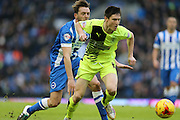 Huddersfield Town midfielder Joe Lolley (18) and Brighton central midfielder, Dale Stephens (6) during the Sky Bet Championship match between Brighton and Hove Albion and Huddersfield Town at the American Express Community Stadium, Brighton and Hove, England on 23 January 2016.