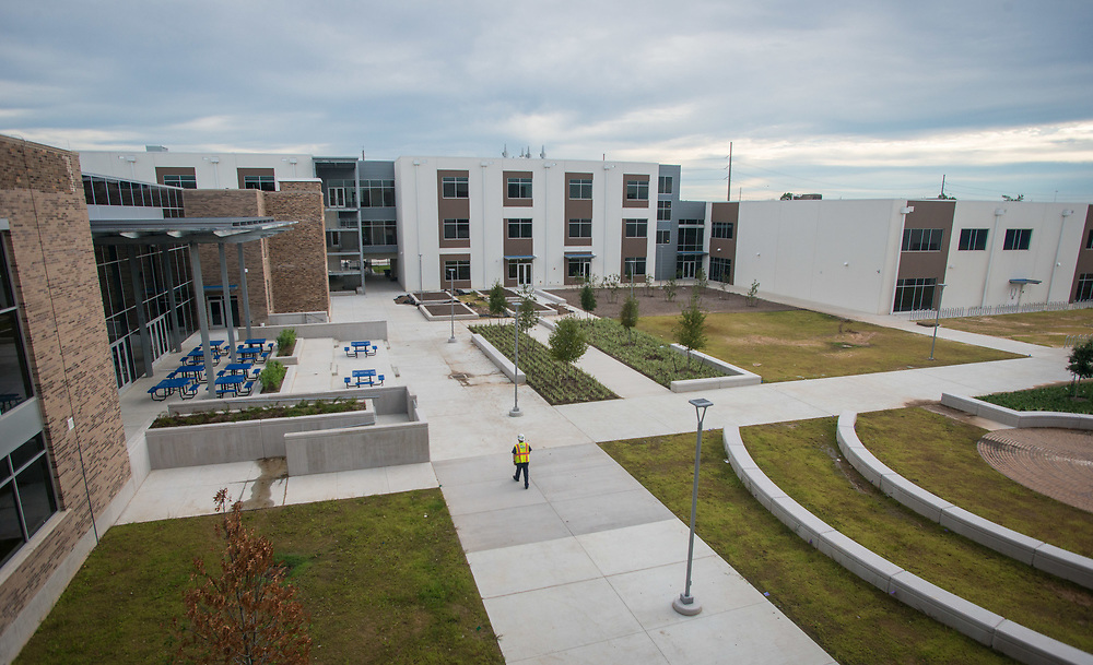 Milby High School's new courtyard shows the blening of the old building with the new addition.