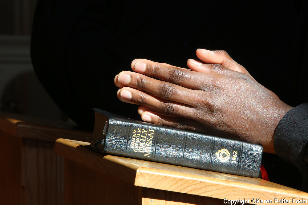 An African American nun in prayer. © Karen Pulfer Focht-ALL RIGHTS RESERVED-NOT FOR USE WITHOUT WRITTEN PERMISSION