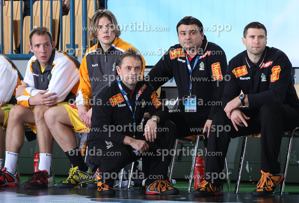 Nikola Kojic (14), Tomas Reznicek (20), Head coach of CPL Tone Tiselj, coach Herman Wirth and coach Rado Ocvirk during the 1st round of EHL Champions League match between RK Celje Pivovarna Lasko (SLO) and Rhein Neckar Lowen (GER), on February 14, 2009, in Arena Zlatorog, Celje, Slovenia. Rhein Neckar Lowen won 34:28.  (Photo by Vid Ponikvar / Sportida)