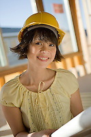 Portrait of young woman in construction site