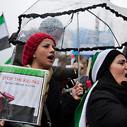 Angry women at an Anti-Assad Syrian demonstration held in Whitehall, Central London. The demonstration was called by the Syrian Community in the UK under the head lines; Syrians are being killed in a genocide and the world is watching. Several hundreds gathered opposite Downing Street 10 calling for Syrians to unite and the world to intervene.