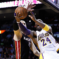 10 March 2011: Los Angeles Lakers shooting guard Kobe Bryant (24) goes for the reverse layup past Miami Heat center Zydrunas Ilgauskas (11) during the Miami Heat 94-88 victory over the Los Angeles Lakers at the AmericanAirlines Arena, Miami, Florida, USA.