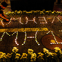 Malaysian lights up candle during a candlelight vigil in remembrance for passengers and crew of the Malaysian Airline flight MH370 & MH17 in Petaling Jaya near Kuala Lumpur,  Malaysia, 23 July 2014. Two military transport aircraft carrying the first bodies from the Malaysia Airlines crash left the eastern Ukrainian city of Kharkiv for the Netherlands on 23 July, as the Ukrainian military said pro-Russian separatists shot down two of its military jets in the east of the country.