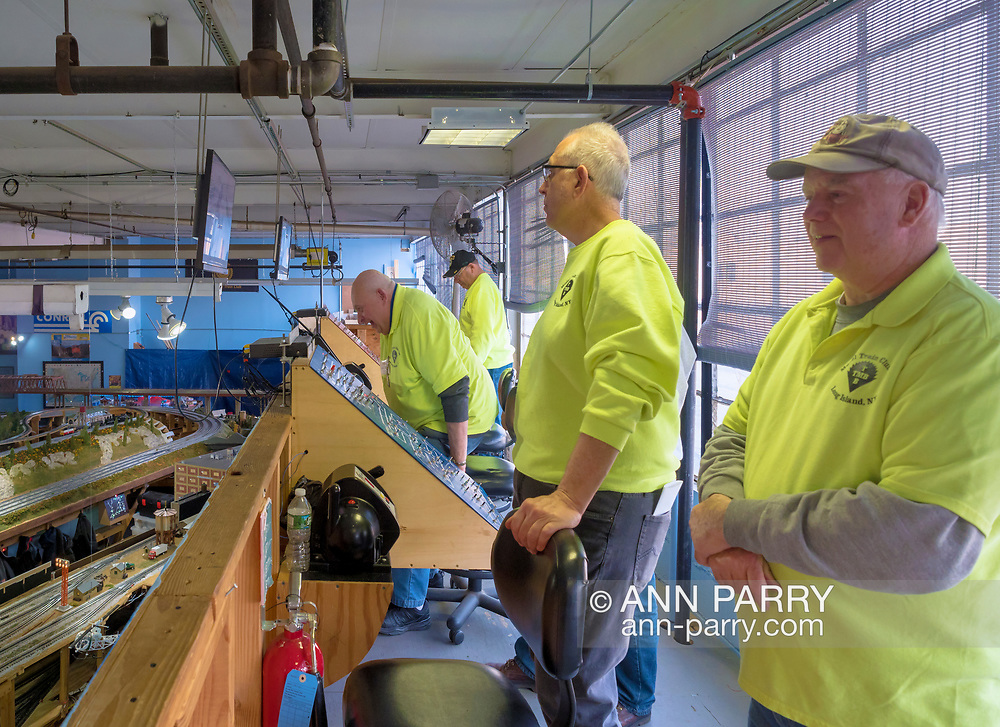 Farmingdale, New York, USA. Jan. 21, 2018. (R-L) TMB members DAVE WILLIAMS, President; STEVE SCAGNELLI, Secretary; JOHN MASSEY and others, work in Controller Loft high up above train layouts during Train Masters of Babylon Open House. (© 2018 Ann Parry/Ann-Parry.com)