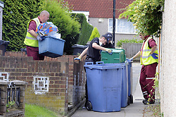 © Licensed to London News Pictures. 09/08/2012 .Police search teams searching rubbish bins with dustmen on The Linden on the sixth day (09.08.2012) Tia Sharp has been missing..  12 years old Tia Sharp has been missing from the Lindens on The Fieldway Estate in New Addington,Croydon,Surrey since Friday last week. .Photo credit : Grant Falvey/LNP