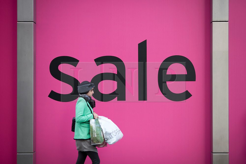 © Licensed to London News Pictures. 26/12/2012. London, UK. As thousands across the UK take advantage of Boxing Day sales a shopper walks past a sale sign on Knightsbridge in London today (26/12/12). Photo credit: Matt Cetti-Roberts/LNP