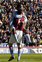 Photo: Richard Lane.<br /> Aston Villa v Birmingham City. Barclaycard Premiership. 22/02/2004.<br /> Darrius Vassell celebrates scoring Villa's first bgoal with Gareth Barry.