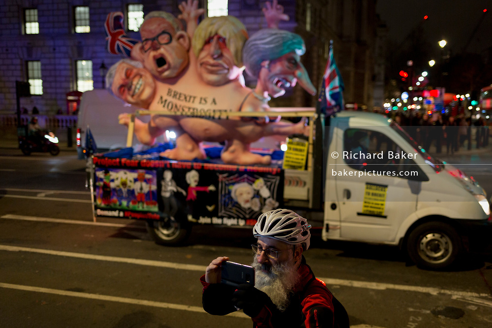 Cyclists and a political parody in Westminster before the result of MPs' Meaningfull Brexit vote which eventually brought about a massive defeat for Prime Minister Theresa May's Conservative government, on 15th January 2019, in Westminster, London, England.