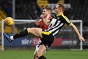Notts County midfielder Robert Milsom (24) clears from Lincoln City midfielder Harry Anderson (26) during the EFL Sky Bet League 2 match between Notts County and Lincoln City at Meadow Lane, Nottingham, England on 2 February 2019.