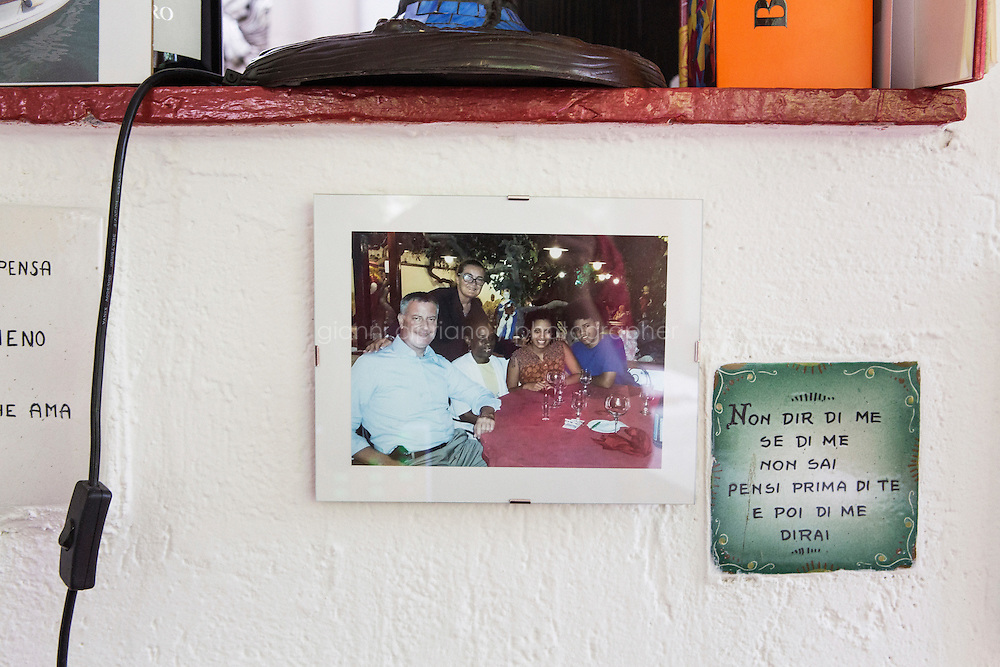 ANACAPRI, ITALY - 22 JULY 2014: A picture of the De Blasio family with Carmen Cappa (2nd from left), owner of the restaurant &quot;Trattoria il Solitario&quot; where they had dinner the evening of their arrival, is here on a wall of the restaurant in Anacapri, a small comune on the island of Capri, Italy, on July 22nd 2014. <br /> <br /> New York City Mayor Bill de Blasio arrived in Italy with his family Sunday morning for an 8-day summer vacation that includes meetings with government officials and sightseeing in his ancestral homeland.