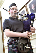 """Jeri Marie Jackson plays """"Amazing Grace"""" on the Bag Pipes at the City of Opelika Memorial Day program Tuesday in the Opelika City Council Chambers.  Photo by Elliot Knight"""