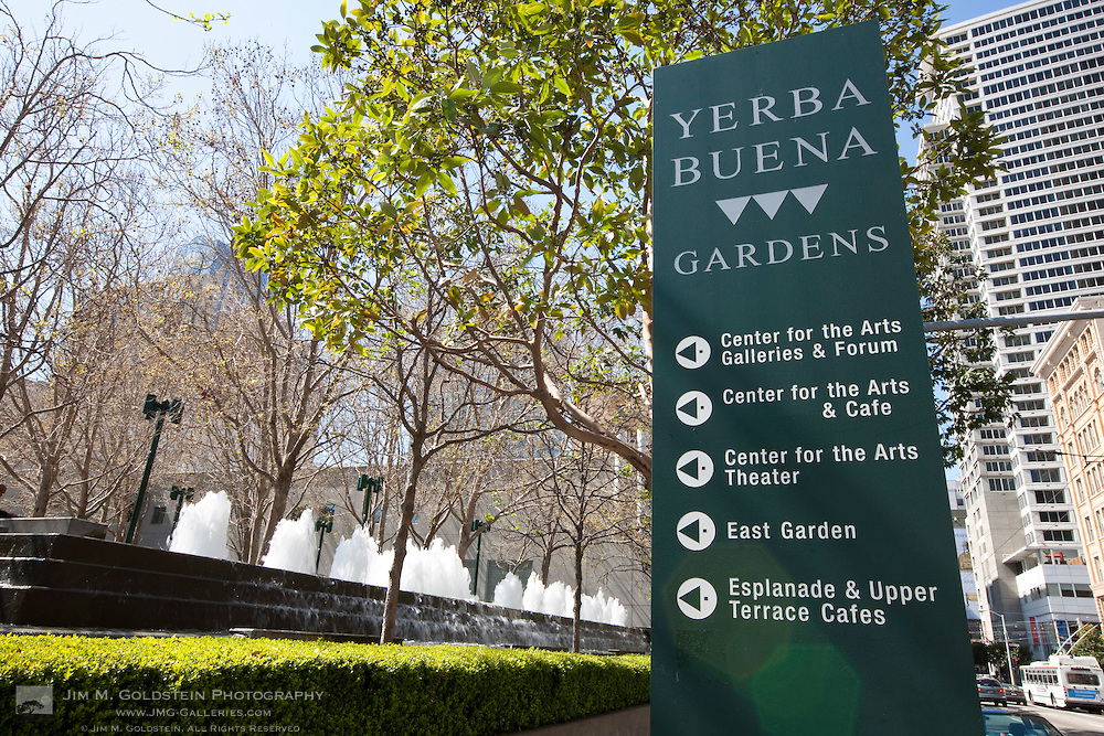 Yerba Buena Gardens information sign with a fountain in the background  - San Francisco, California