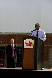 19 September 2009: Will Robinson Jr. takes the podium to make a statement as he accepts the honor in remembrance of his late father who passed away in 2008, Doug Collins looks on.  Illinois State University took the day to celebrate 2 of it's own, the late Will Robinson and national hero Doug Collins.  Will Robinson became the first black head basketball coach in NCAA Division I history when names ISU basketball coach in 1970.  Doug Collins was an Illinois State standout basketball player who represented the United States in the 1972 Olympics, played NBA ball for several years where he later coached and recently recieved the Curt Gowdy Media Award for career in broadcasting.  A statue was erected in their honor on the terrace just north of the main entrance to Redbird Arena on ISU's campus in Normal IL
