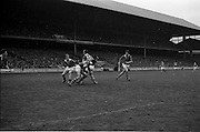 17/10/1965<br /> 10/17/1965<br /> 17 October 1965<br /> Oireachtas Final: Kilkenny v Tipperary at Croke Park, Dublin.<br /> Tipperary goalie, O'Donoghue, comes out from the goal with the ball in his hands to make a clearance, as Maher (3) holds off a Kilkenny forward.