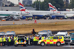 © Licensed to London News Pictures. 06/09/2016. London, UK. Protestors from the Black Lives Matter group are seen on the runway at London City Airport.  All flights in and out of the airport are disrupted. Photo credit: Tolga Akmen/LNP