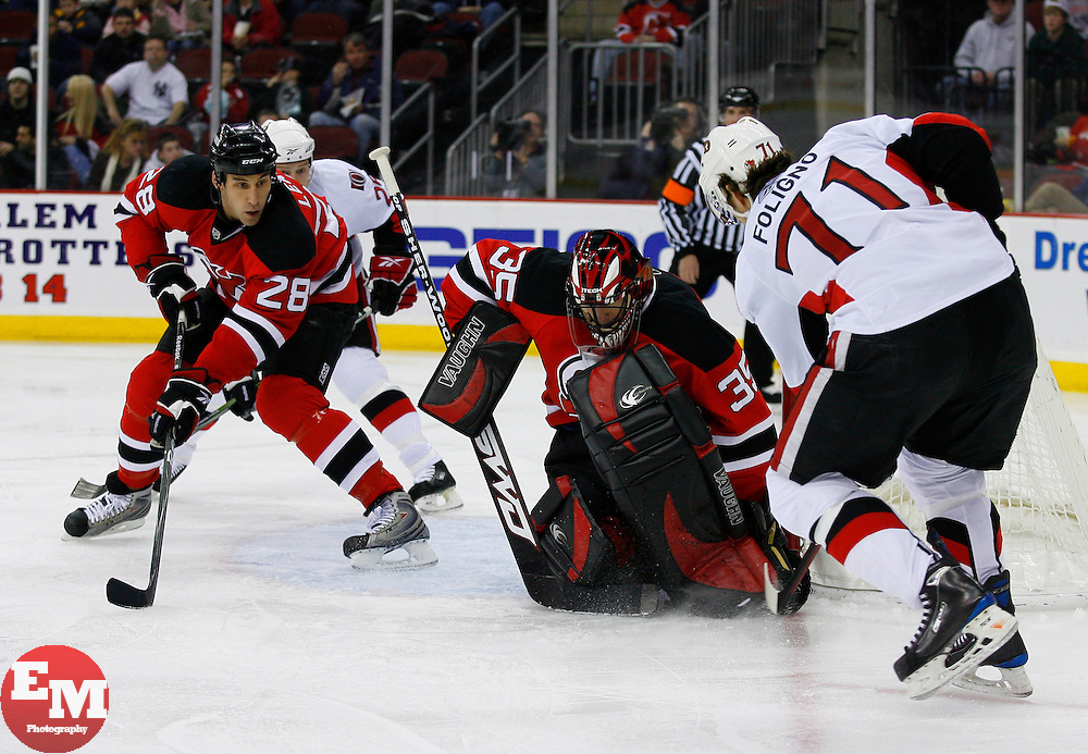 Jan 4, 2008; Newark, NJ, USA; Ottawa Senators left wing Nick Foligno (71) slides the puck by New Jersey Devils goalie Scott Clemmensen (35) and into the goal during the first period at the Prudential Center.