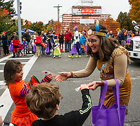 Children's Dentisty hands out Halloween toothbrushes during the Pumpkin Fest parade on Saturday afternoon.  (Karen Bobotas/for the Laconia Daily Sun)