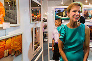 19 JULY 2013 - BANGKOK, THAILAND:   KRISTIE KENNEY, the US Ambassador to Thailand, at the opening of a photo exhibit sponsored by the US Embassy in Bangkok. The photo exhibit celebrates 180 years of US-Thai diplomatic relations. There are 180 photos hanging in the show, 90 by American photographers in Thailand and 90 by Thai photographers in the United States. The show, which opened July 19, is hanging in CentralWorld, a large mall in Bangkok, and is touring Thailand when it concludes its Bangkok run on July 21.   PHOTO BY JACK KURTZ