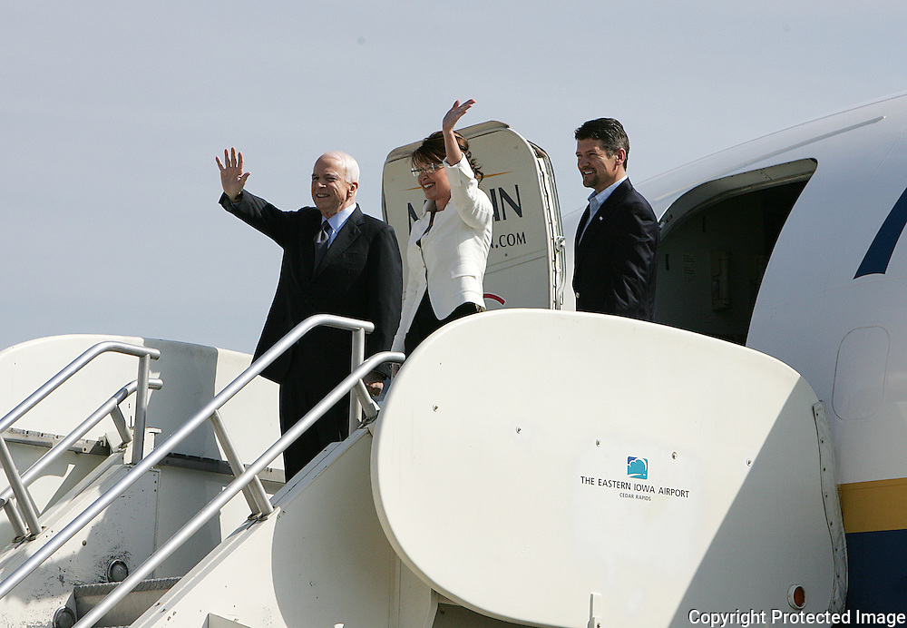 US Republican presidential nominee Senator John McCain (R-AZ) and his running mate Alaska Governor Sarah Palin wave to the crowd as they arrive for a campaign rally in Cedar Rapids, Iowa, September 18, 2008.