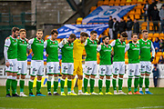 The Hibs team observe a minutes silence in memory of Remembrance Sunday before the Ladbrokes Scottish Premiership match between St Johnstone FC and Hibernian FC at McDiarmid Park, Perth, Scotland on 9 November 2019.