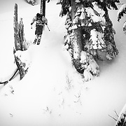 Tyler Hatcher drops off of a dead tree stump in the Mount Baker backcountry.