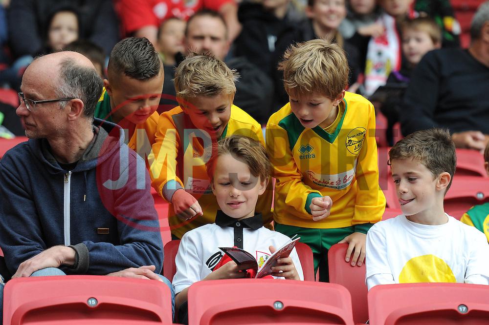 Young Bristol City fans read a programme - Mandatory byline: Dougie Allward/JMP - 07966 386802 - 03/10/2015 - FOOTBALL - Ashton Gate - Bristol, England - Bristol City v MK Dons - Sky Bet Championship