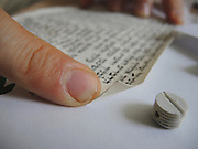 parchment of the mezuzah inscribed with specified Hebrew verses from the Torah (Deuteronomy 6:4-9 and 11:13-21). These verses comprise the Jewish prayer Shema Yisrael, beginning with the phrase: Listen, Israel, the Lord is our God, the Lord is One.