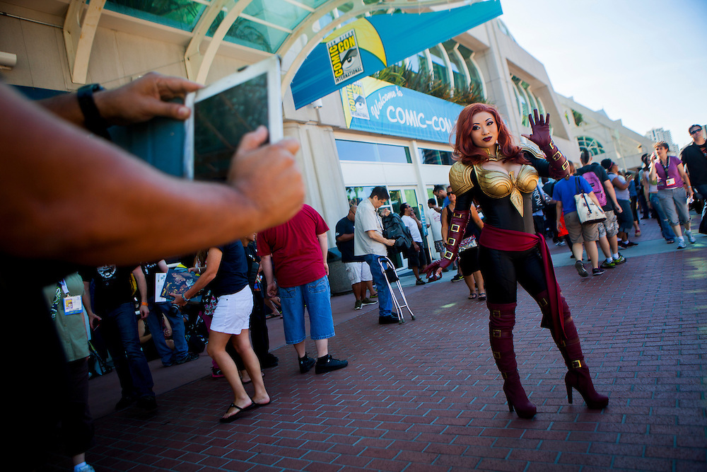 Cosplayer Yaya Han poses for fans at Comic Con portraying Phoenix from Marvel Avengers Alliance.