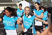 Courtney Chalmers, 13 of the Southbridge Netball Club and team mates warm up during the ANZ Championship Roadshow, Win a Warmup, held at the Selwyn Netball Centre, Lincoln. 17 May 2014 Photo: Joseph Johnson/www.photosport.co.nz