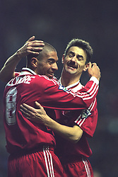 LIVERPOOL, ENGLAND - Saturday, January 6, 1996: Liverpool's Stan Collymore celebrates scoring the third of his hat-trick of goals with team-mate Ian Rush against Rochdale during the FA Cup 3rd Round match at Anfield. (Photo by David Rawcliffe/Propaganda)
